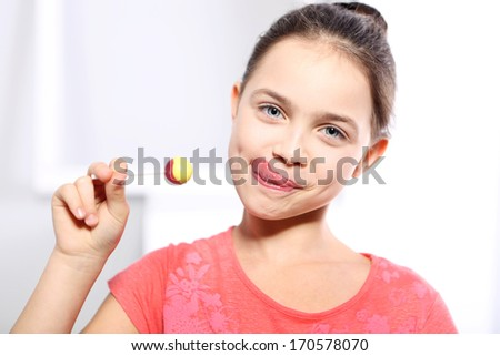 Girl with lollipop  / Young girl in a pink shirt with lollipop