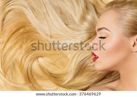Girl with long blond hair #376469629
