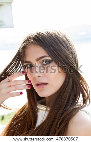 girl with long hair and bright makeup #478870507