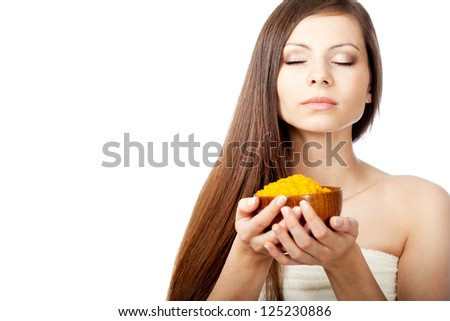 girl with long hair closed her eyes and holding bowl  of sea salt