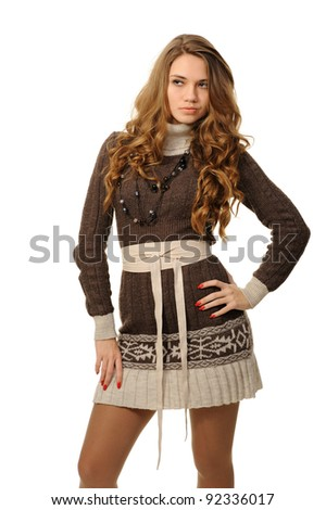 Girl with long hair in a warm dress