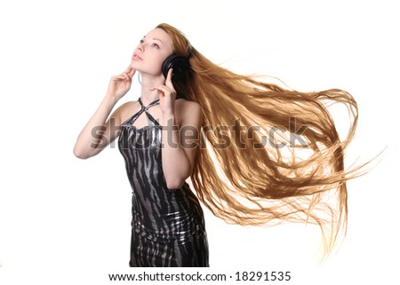 Girl with long hair listening to music on headphones