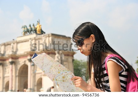 Girl with map in Paris, at the Arc de Triomphe du Caroussel