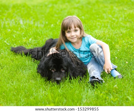 Girl with Newfoundland dog