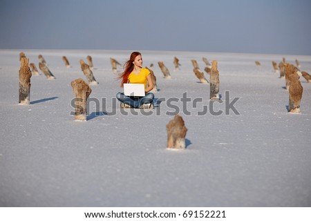 girl with notebook on the salt sand