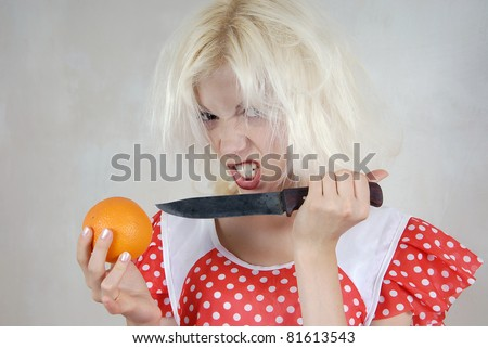 Girl with orange and knife