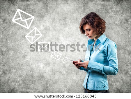 Girl with phone and letters flying upwards