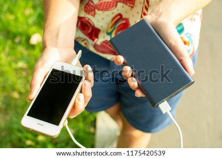 girl with phone and power bank #1175420539