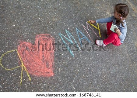 "Girl with pigtails wrote in chalk on the pavement, ""I love mom"""