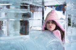 Girl with pink hat and ice sculpture