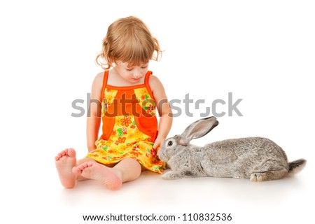 Girl with rabbit, isolated on white