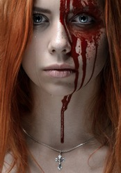 Girl with red hair, bloody face, a chain with a cross, blue eyes, vampire, murderer, psycho, halloween theme, studio shot, bloody woman
