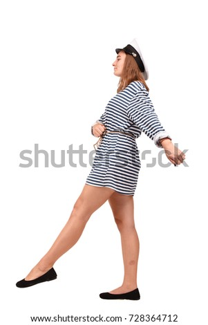 Girl with red hair dressed in stripes dress #728364712