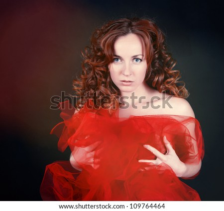 Girl with red hair portrait in studio
