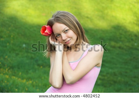 Girl with red tulip - stock photo
