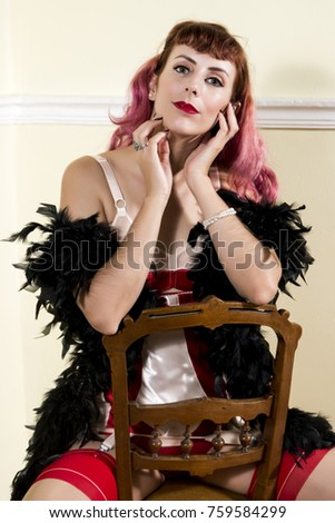 Girl with red vintage lingerie with classic chair. #759584299