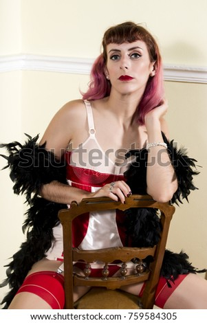 Girl with red vintage lingerie with classic chair. #759584305