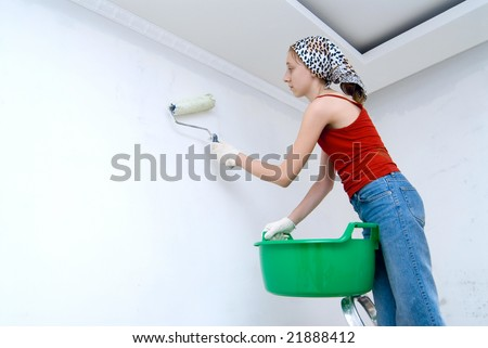 girl with roller in apartment