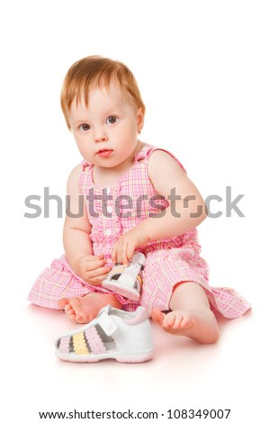 Girl with sandals, isolated on white