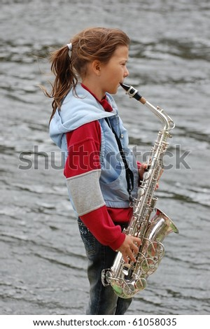 Girl with saxophone - stock photo
