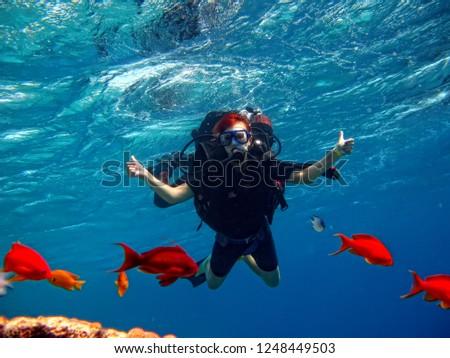 girl with scuba #1248449503