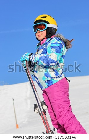 Girl with ski on the snow