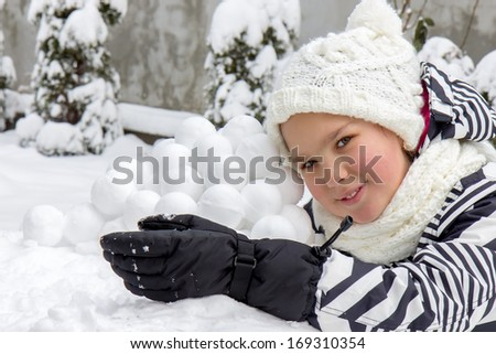 Girl with snowballs
