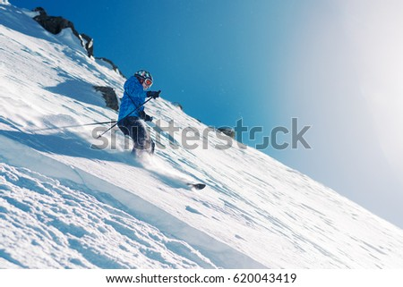 girl with special ski equipment is riding fast, jumping, freeriding very fast in the mountain forest #620043419