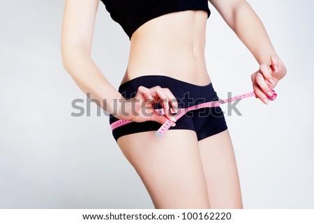Girl with sport figure metering her body