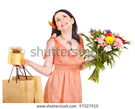 Girl with spring flower, gift box and shopping bag.  Isolated.