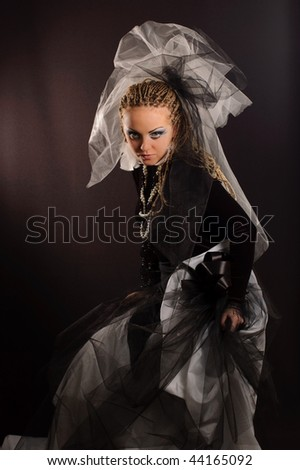 Girl with stage makeup in theatrical