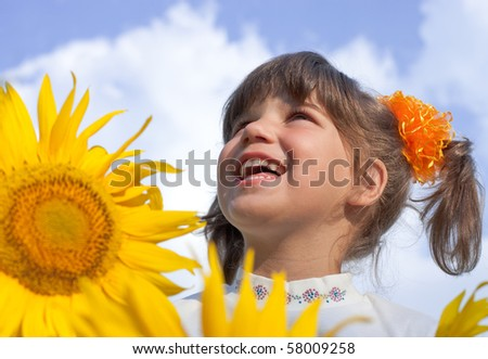 girl with sunflowers - stock photo