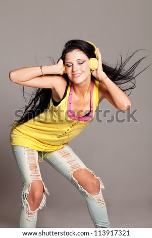 Girl with tank top listening to the music