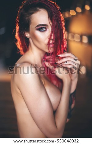 Stock Photo Girl with tattoos pink hair and piercings ,posing in underwear