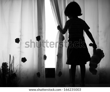 Girl with teddy bear in hand waiting for a friend