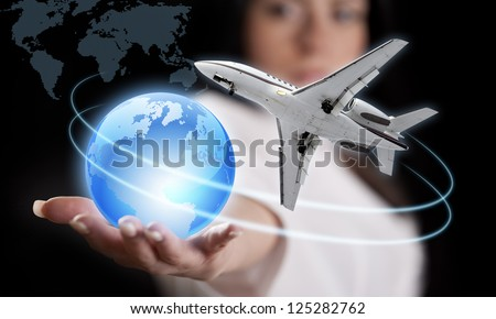 Girl with the planet Earth and the airliner.