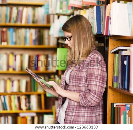 girl with touchpad in library