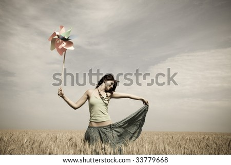 girl with toy wind turbine at...