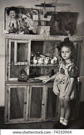 girl with toys  old photos