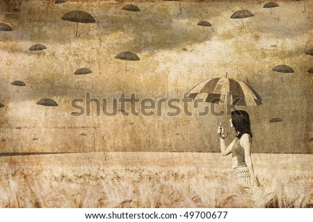 Girl with umbrella at field in umbrella's rain time. Photo in old image style.