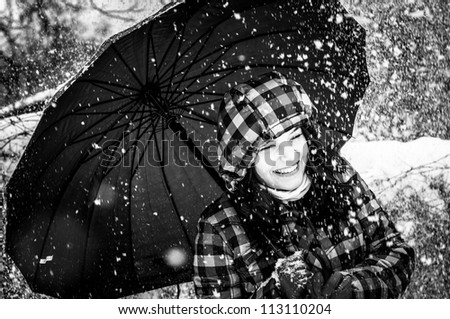 Girl with umbrella in the snow closeup