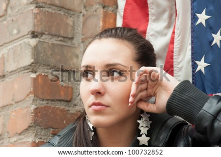 Girl with USA flag (near the brick wall)