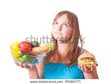 girl with vegetables and hamburger