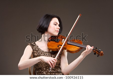 Girl with violin in gold dress