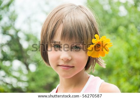 Girl with yellow flower in hair