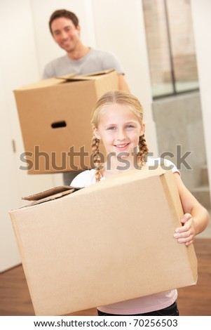 Girl with young man on moving day carrying cardboard box