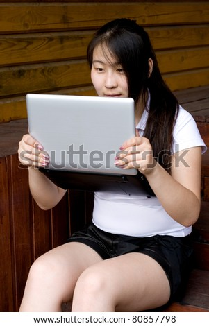 Girl working on laptop outdoor
