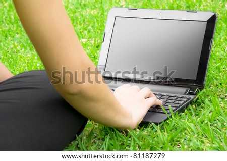 Girl Working with laptop in the field