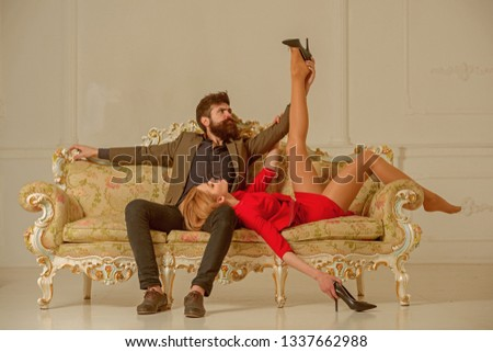 girlfriend and boyfriend relax on couch. sexy girlfriend has slim legs. bearded boyfriend undress girl. boyfriend and girlfriend relations. man with attractive girlfriend. woman relax with boyfriend