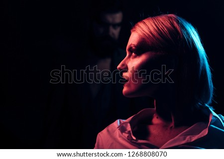 Girlfriend. Girlfriend with makeup face profile. Girlfriend in glamour style with blurred man on dark background.
